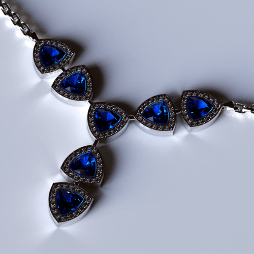 a modern white gold necklace with diamonds and sapphire gemstones